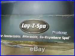 Lay-Z-Spa Miami Inflatable Hot Tub Holds Up To 4 Adults With Massage System