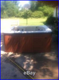 USED 5-6 PERSON HOT TUB WITH LOUNGE
